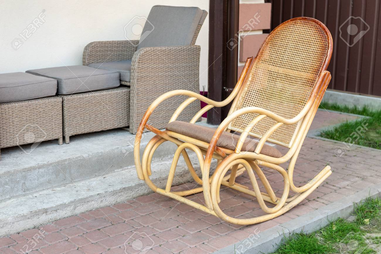 Empty Wooden Rattan Rocking Chair On House Terrace Backyard Outdoors