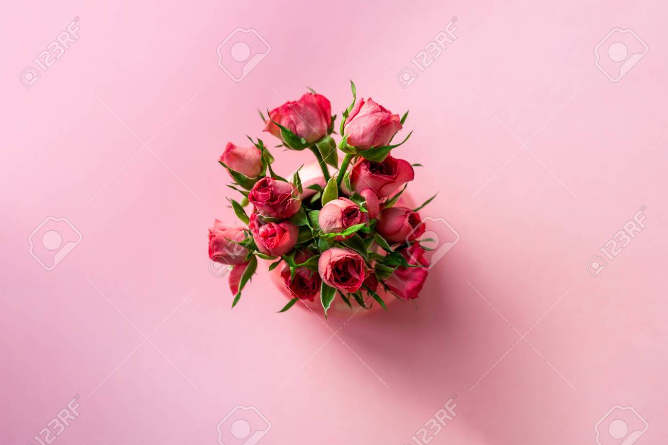 Above Top View Of Minimalist Tender Small Pink Rose Flower Bouquet Stock Photo Picture And Royalty Free Image Image 152466653