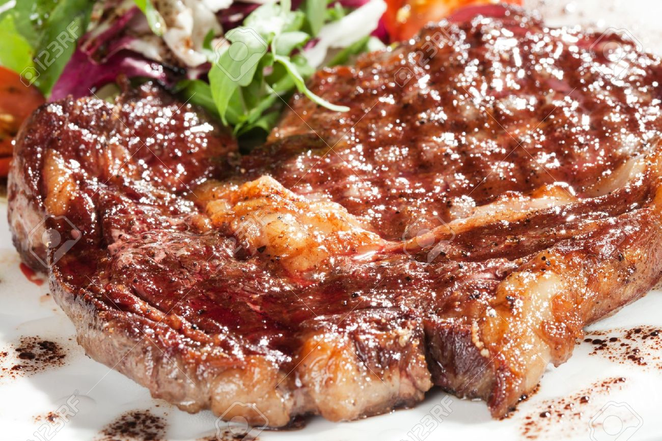 Gourmet grilled steak on a plate Stock Photo - 12166296