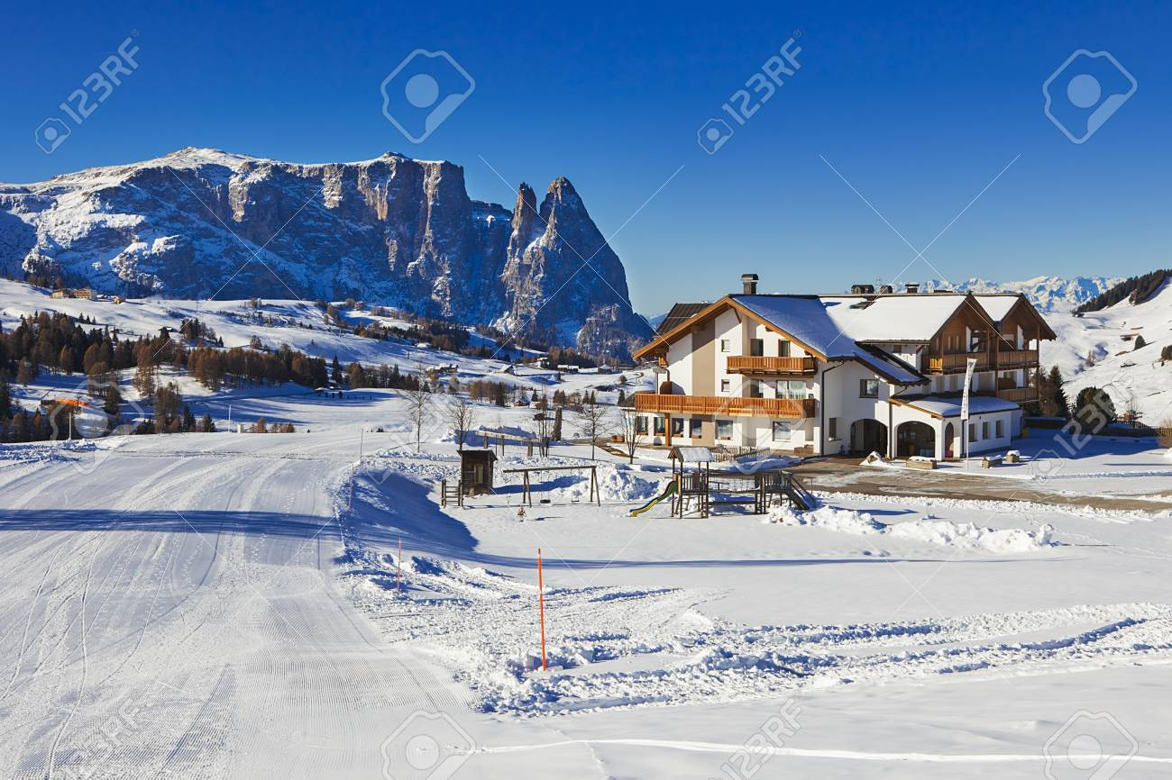 winter panorama of italian ski resort with background of seiser