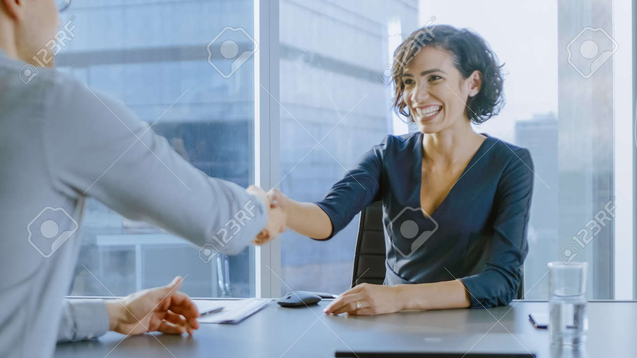 Beatiful Young Businesswoman Talks with a Potential Business Partner and Shakes Hands When them come to a Agrement. Strong Independent Woman in Business Situation. - 159764745