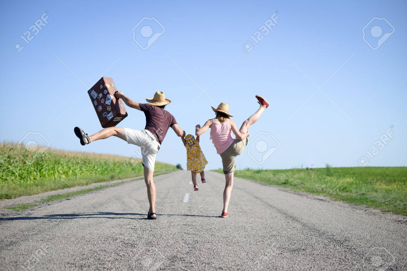 Picture Of Merry Family Jumping And Dancing On Road In Summertime ...