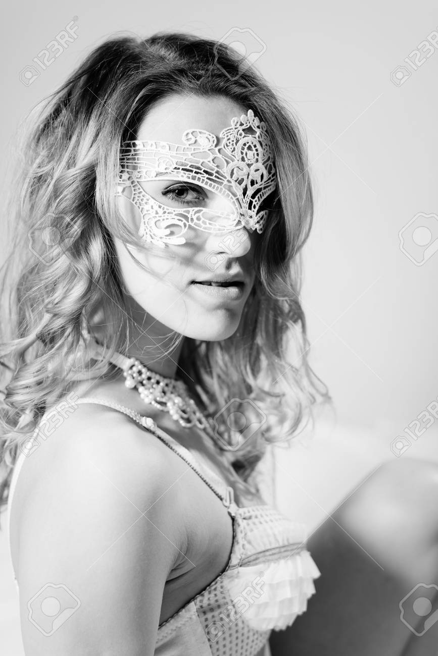 Black and white photography of lovely pinup girl vintage style sexy lady wearing mask on