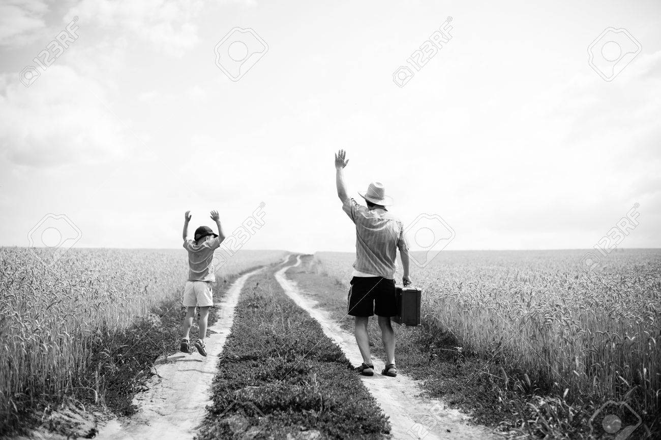 Black And White Picture Of Father And Son Travelling Family With