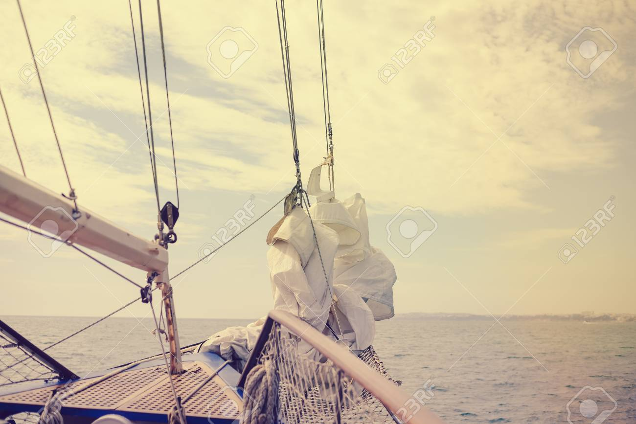 Vintage picture of beautiful sail boat details  Rope, hull, rigging