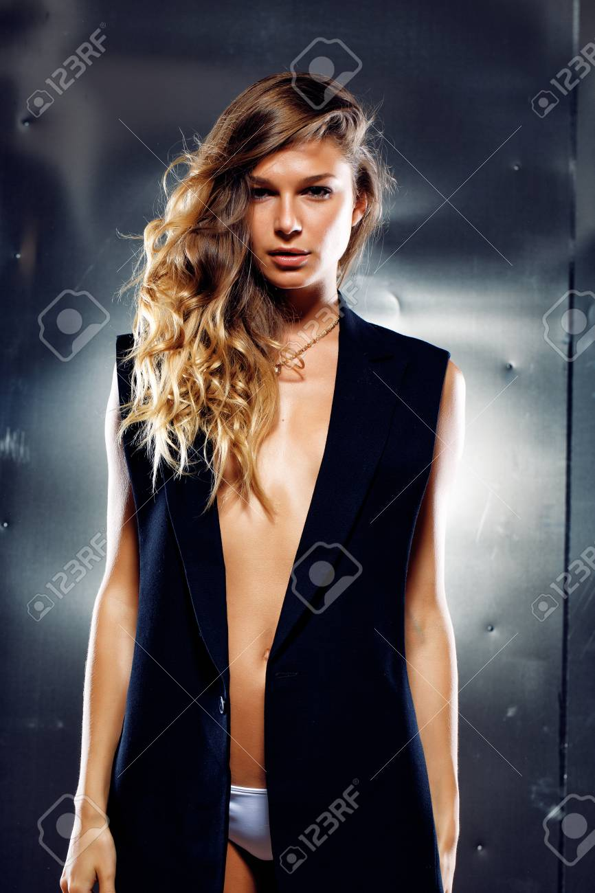 Sexy model in the black vest on grey background Stock Photo - 57399667