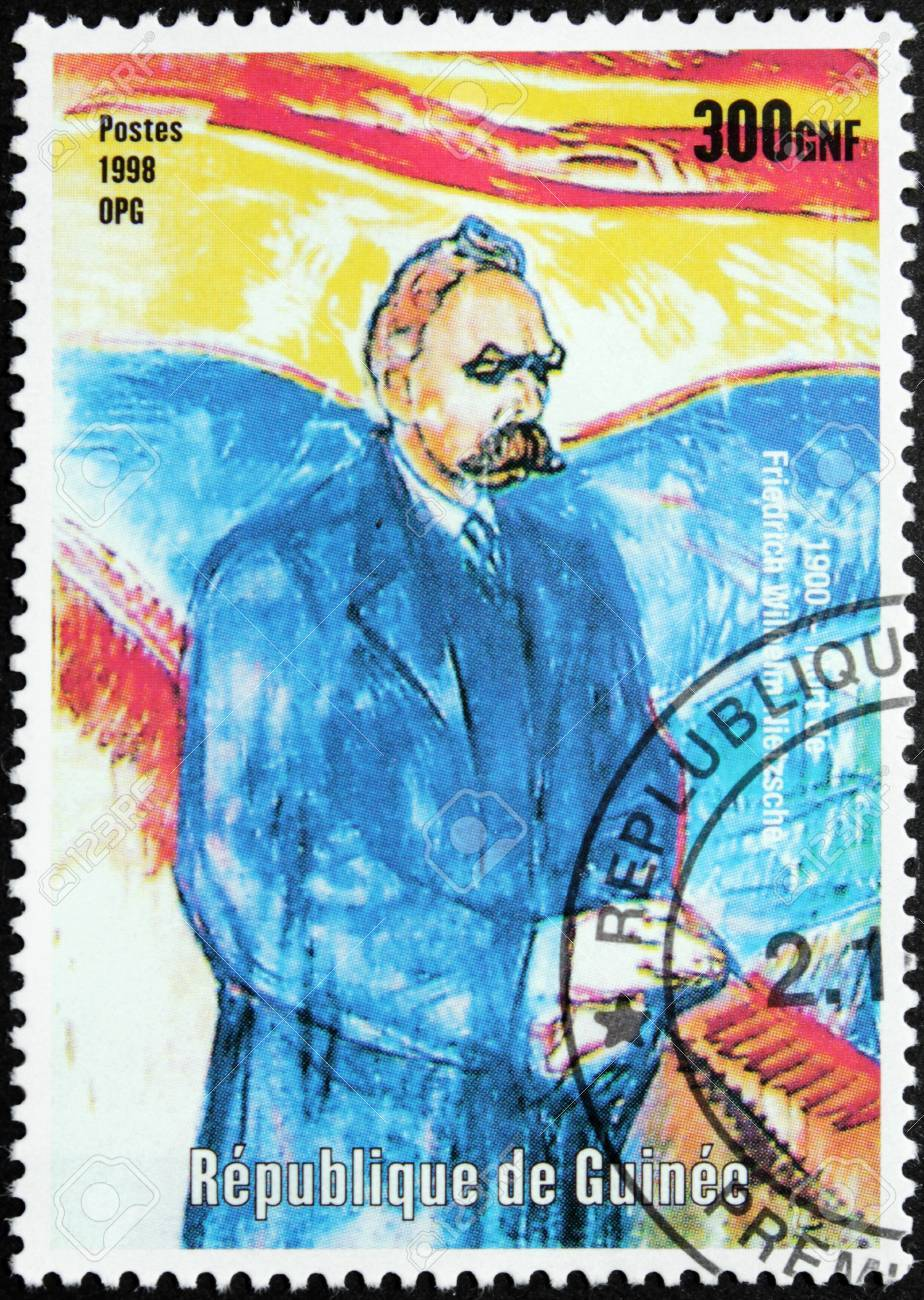GUINEA - CIRCA 1998. A postage stamp printed by GUINEA shows image portrait of famous German philosopher, poet and cultural critic Friedrich Wilhelm Nietzsche, circa 1998. Stock Photo - 14963203