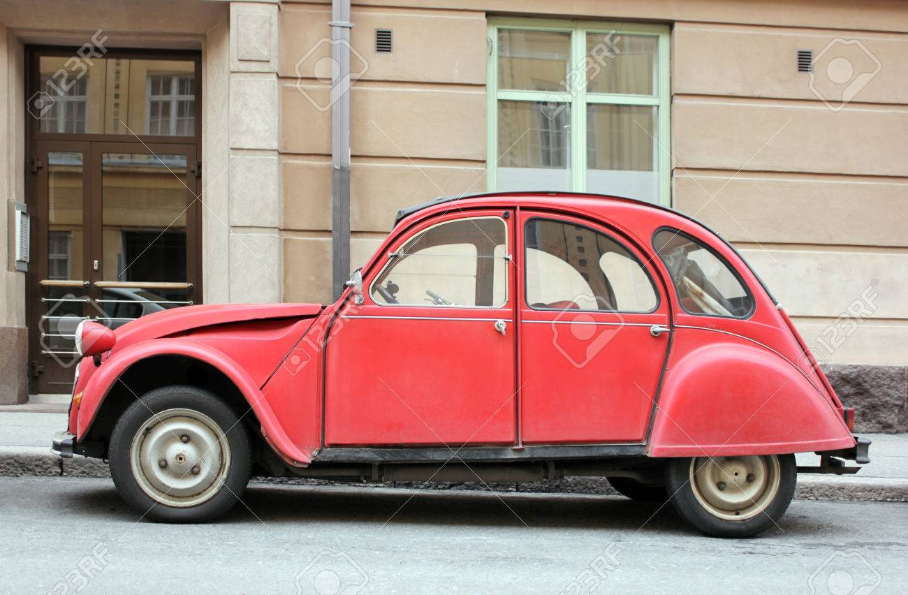 Side View Of Old Small Red Car At European Street. Stock Photo ...