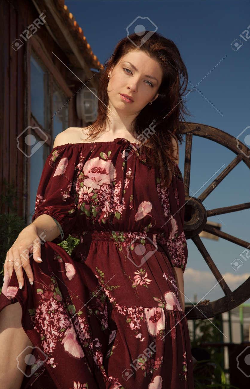 Beautiful rural girl near the dwelling. Stock Photo - 4964421