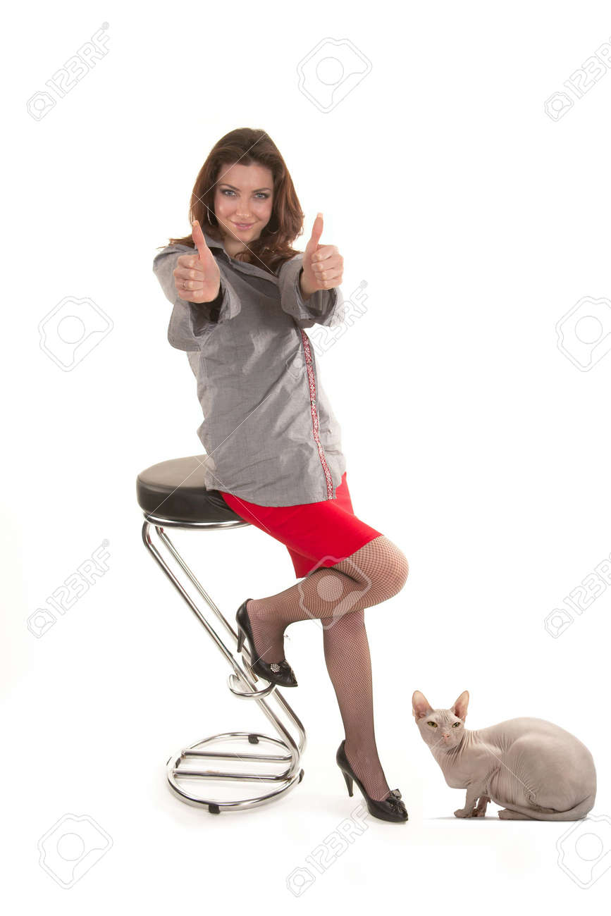 Girl to a red skirt among cats on a white background Stock Photo - 6714749