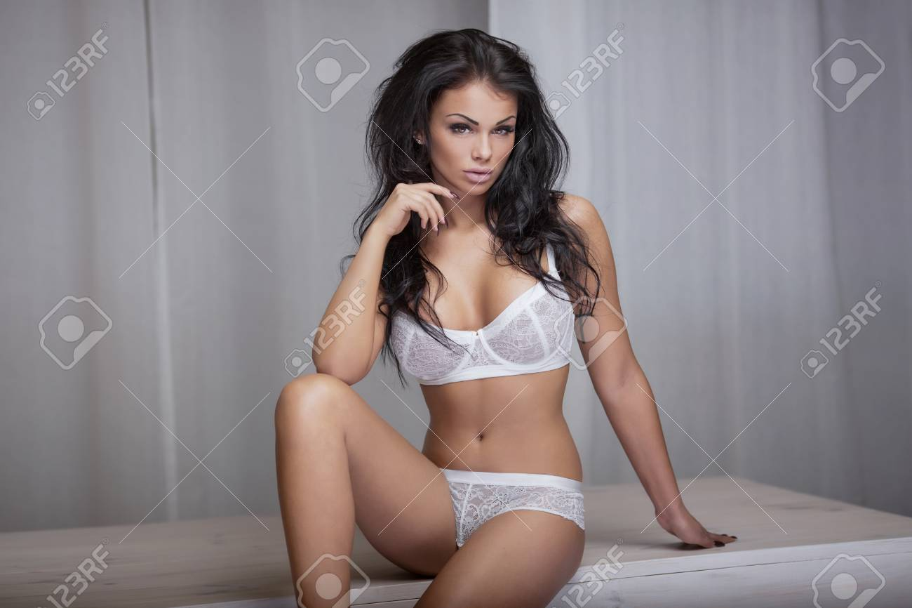 cd1b1edc3 Sexy beautiful young woman posing in white lingerie. Girl with perfect body  and long hair