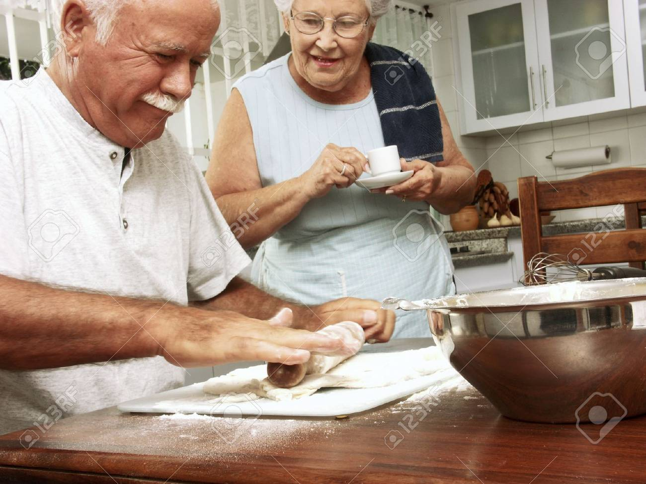 An elderly couple preparing food in the kitchen Stock Photo - 22542519