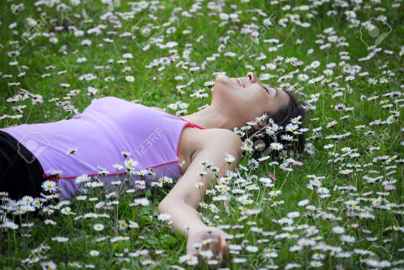 Beautiful Woman Lying In Field Of Flowers Stock Photo Picture And