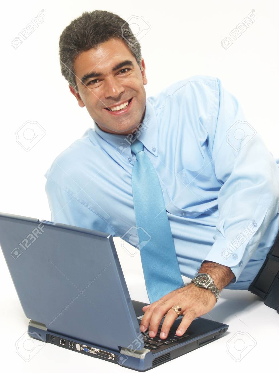 Businessman is using his laptop while sitting on the floor Stock Photo - 22521145