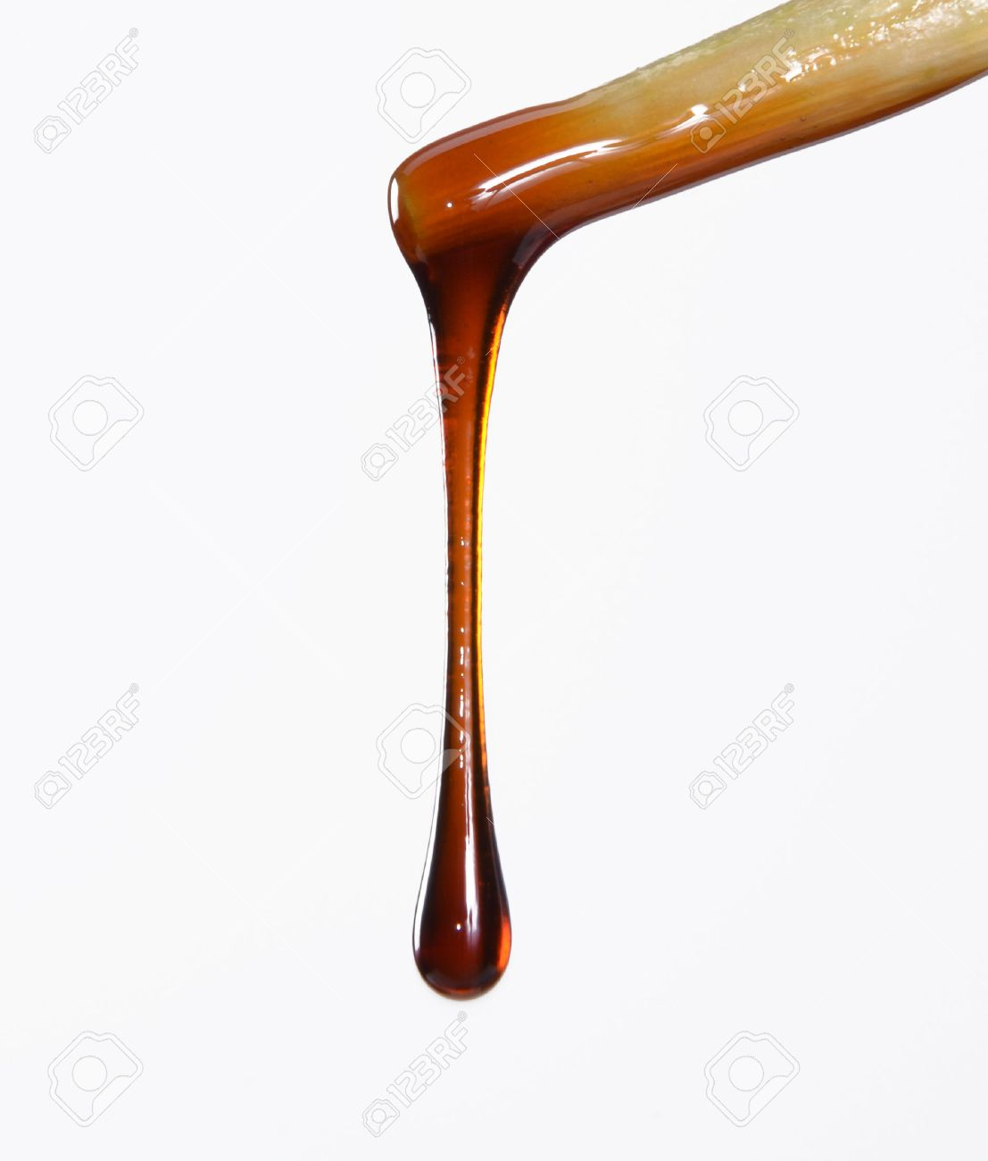 sauce dripping off a chopstick stock photo, picture and royalty free