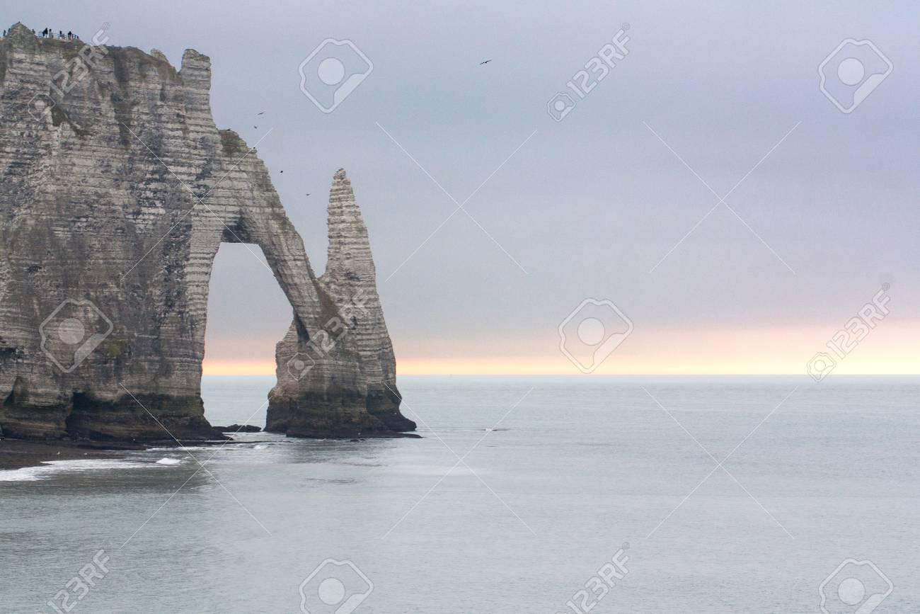 Chalk cliffs on the sides of Alabaster at Etretat in Normandy Seine Maritime - France Stock Photo - 25943949