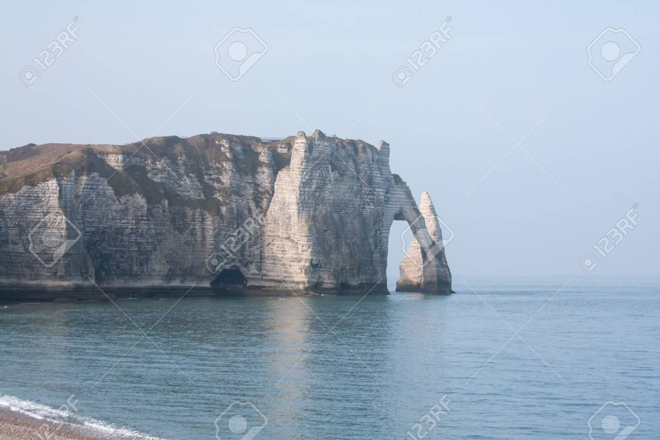 Chalk cliffs on the sides of Alabaster at Etretat in Normandy Seine Maritime - France Stock Photo - 25943950