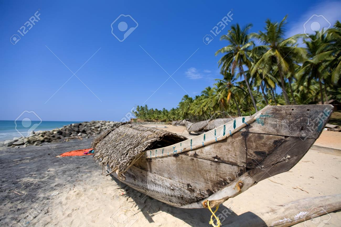 Fisher man boat on the Varkala beach in India Stock Photo - 4410288