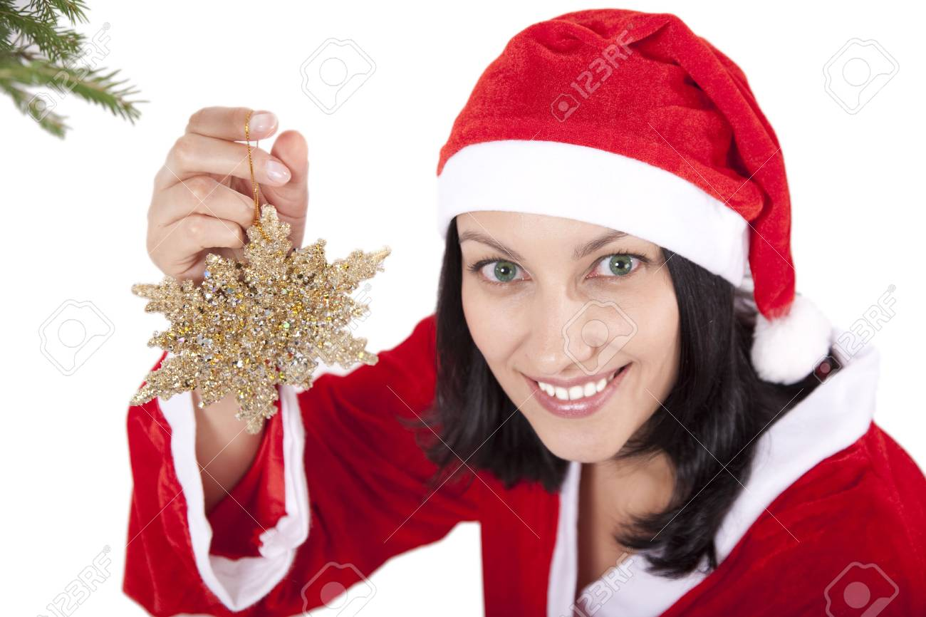 Smiling girl in christmas cap with toy in hand over white Stock Photo - 5486279