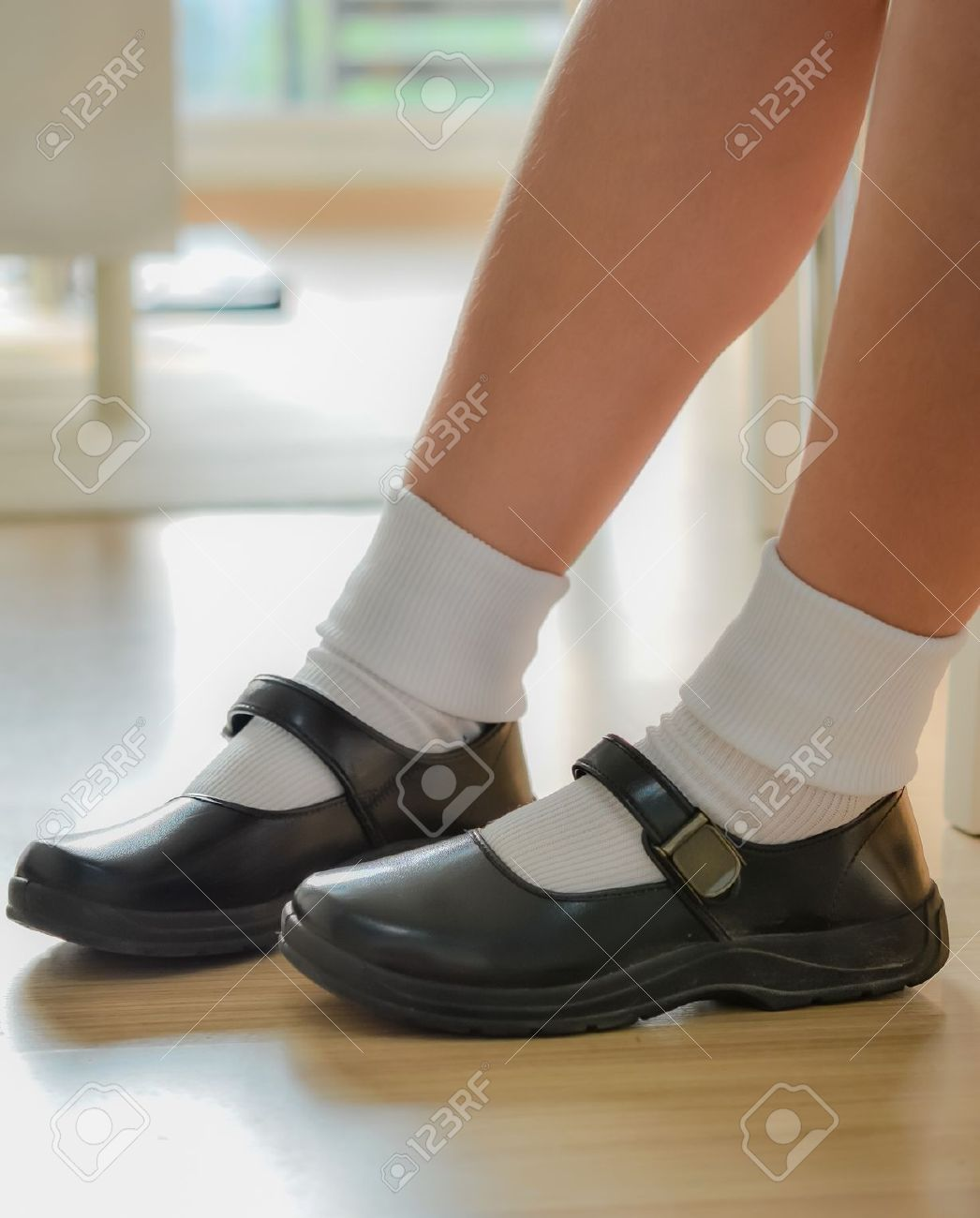 Thai Girls Wear A Black Leather Shoes