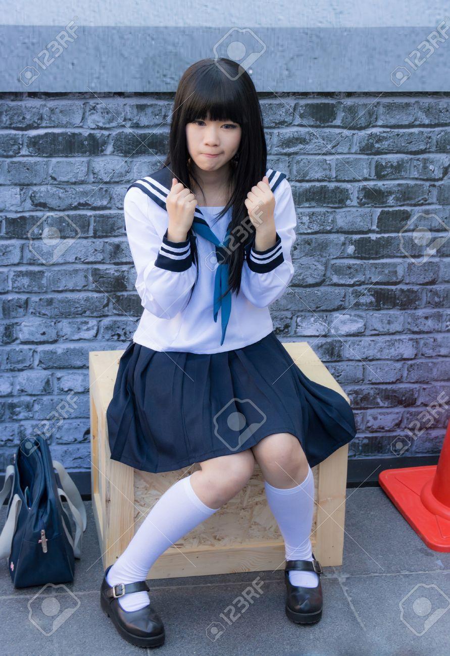 Japan teen schoolgirl BANGKOK, THAILAND - MARCH 31: Cute Thai cosplayer dresses as Japanese  schoolgirl posing for