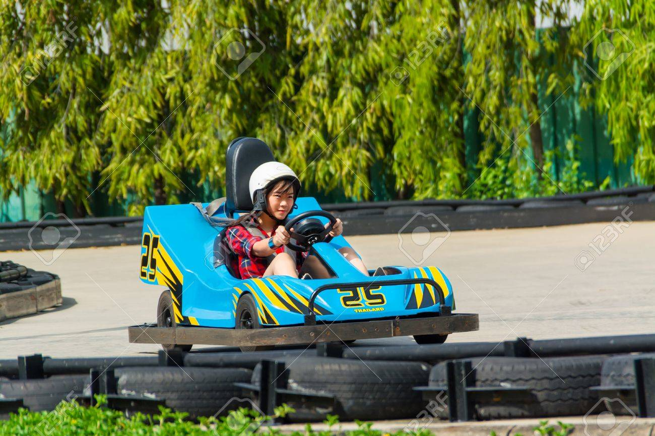 thai kart Cute Thai Girl Is Driving Go kart With Speed Stock Photo, Picture  thai kart