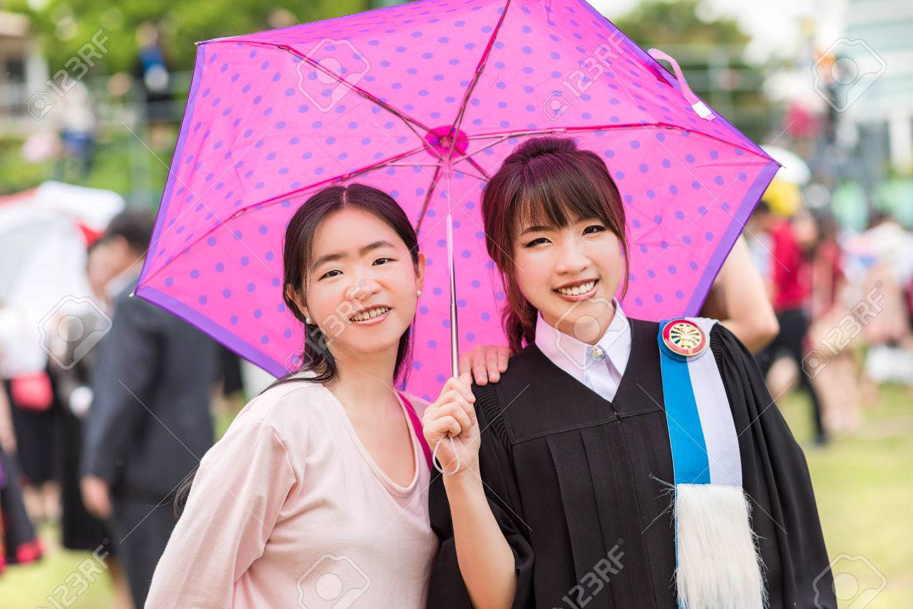 Stock Photo Thai Girl Graduate College Girls Are Under An Umbrella From Summer Hot Weather