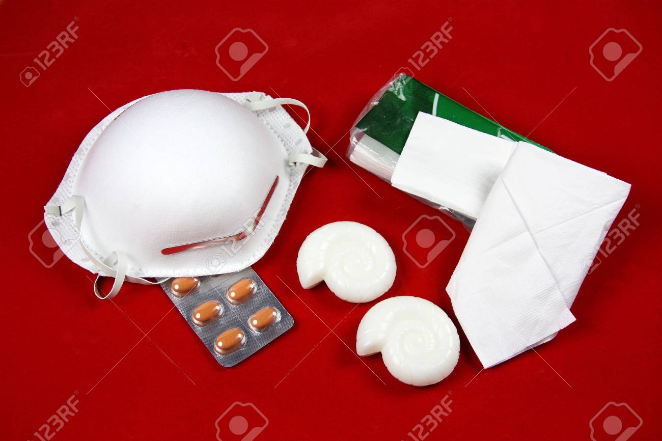 The essentials for avoiding the spread of the A(H1N1) virus - a mask, tissues, antivirals and handsoap Stock Photo - 4878036