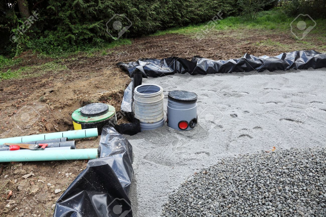 Installing a sand and gravel filter bed with filters and pump..