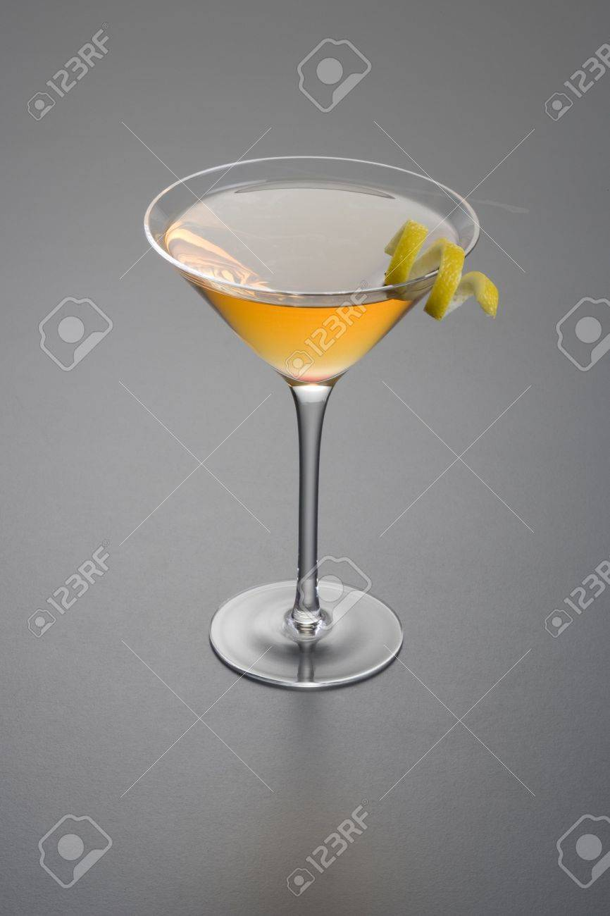 Manhattan Cocktail With Lemon Peel Garnish Close Up On Grey Background Stock Photo Picture And Royalty Free Image Image 6391008