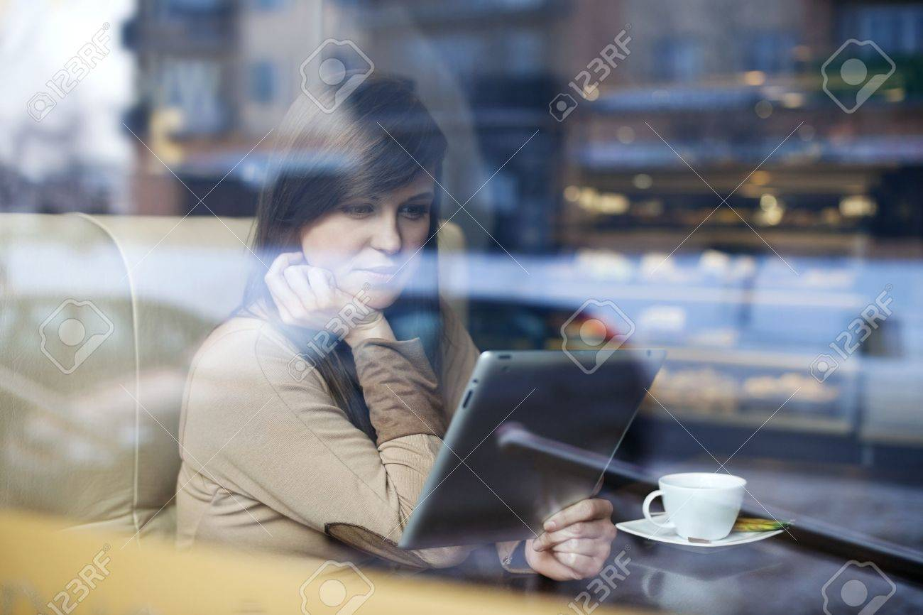 Young woman using tablet in coffee shop Stock Photo - 18161934