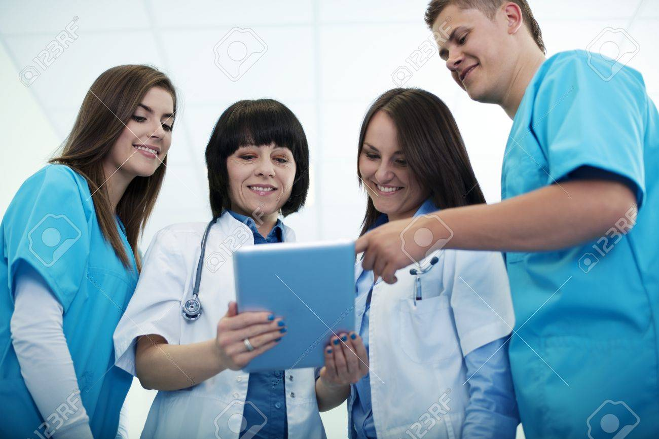 Medical team checking results on digital tablet Stock Photo - 18182424