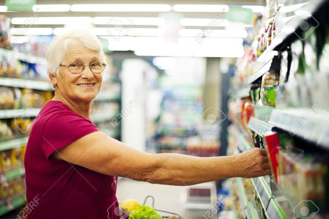 Happy senior woman at supermarket Stock Photo - 18184409