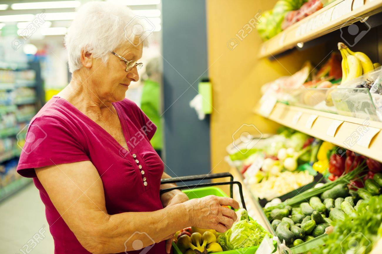 Senior woman at supermarket Stock Photo - 18184364