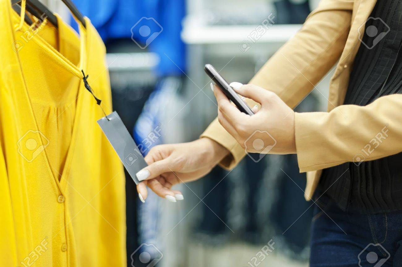 Woman scanning QR code in shopping mall Stock Photo - 18184804