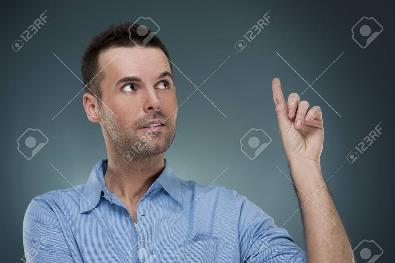 Handsome man pointing at copyspace Stock Photo - 18191013