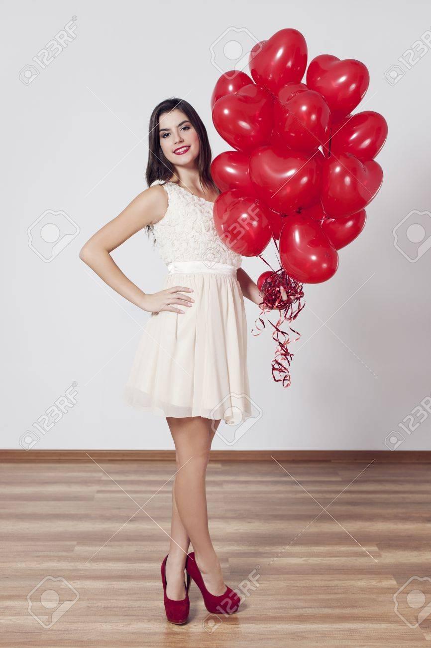 Woman holding many balloons in heart-shaped Stock Photo - 18190920