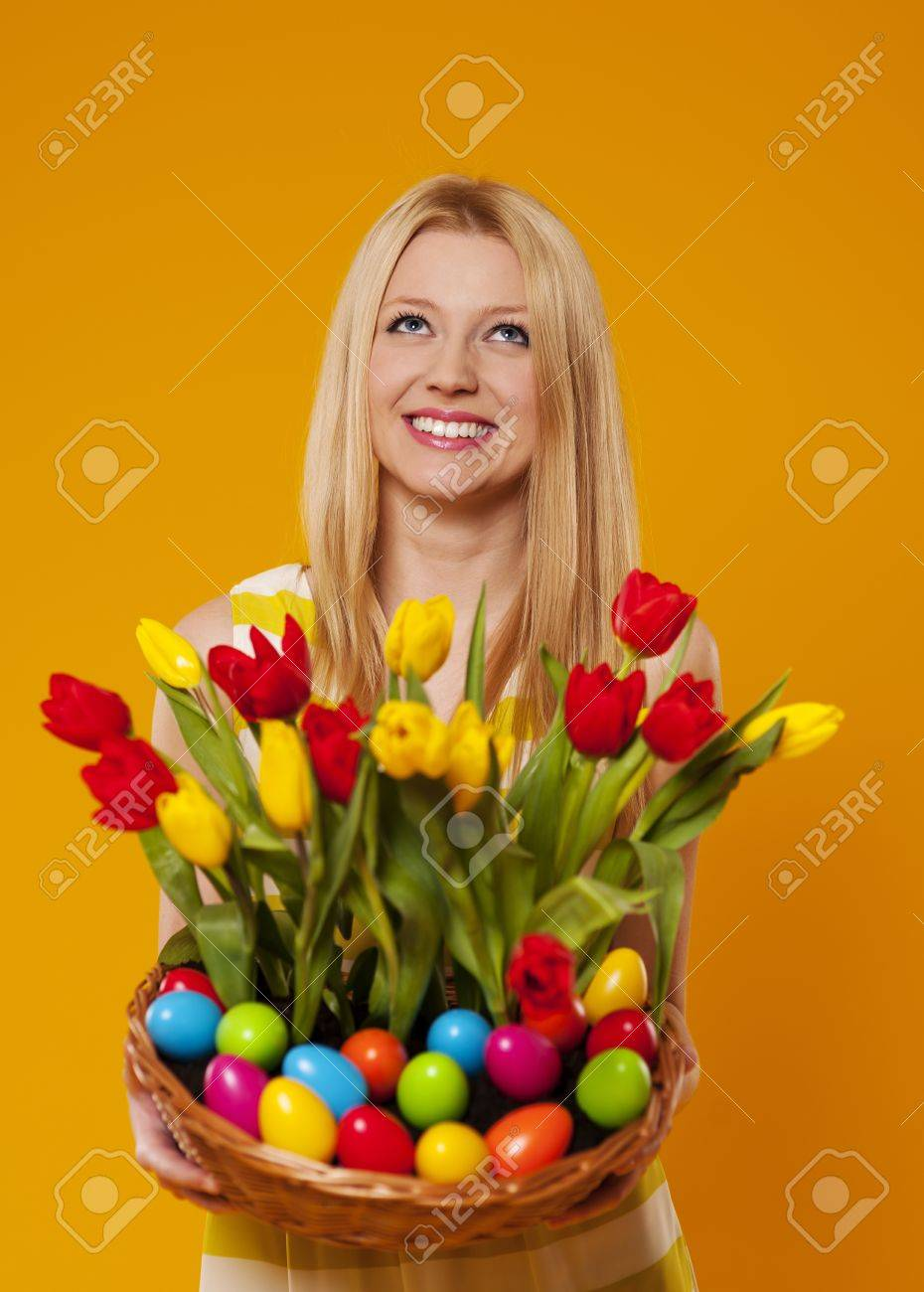 Happy woman holding basket with spring flower and easter eggs Stock Photo - 18208337