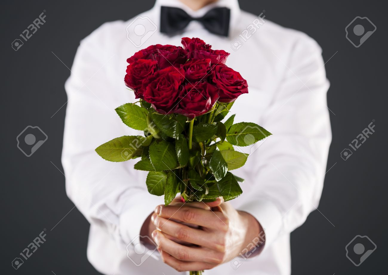 Man Giving Bouquet Of Red Roses Stock Photo, Picture And Royalty ...