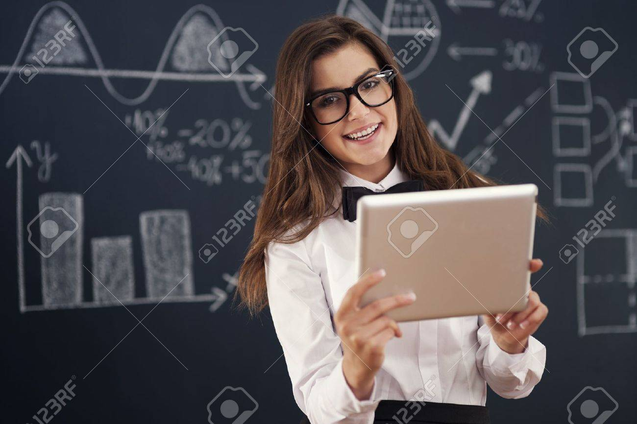 Smiling  teacher using digital tablet in classroom Stock Photo - 19698649