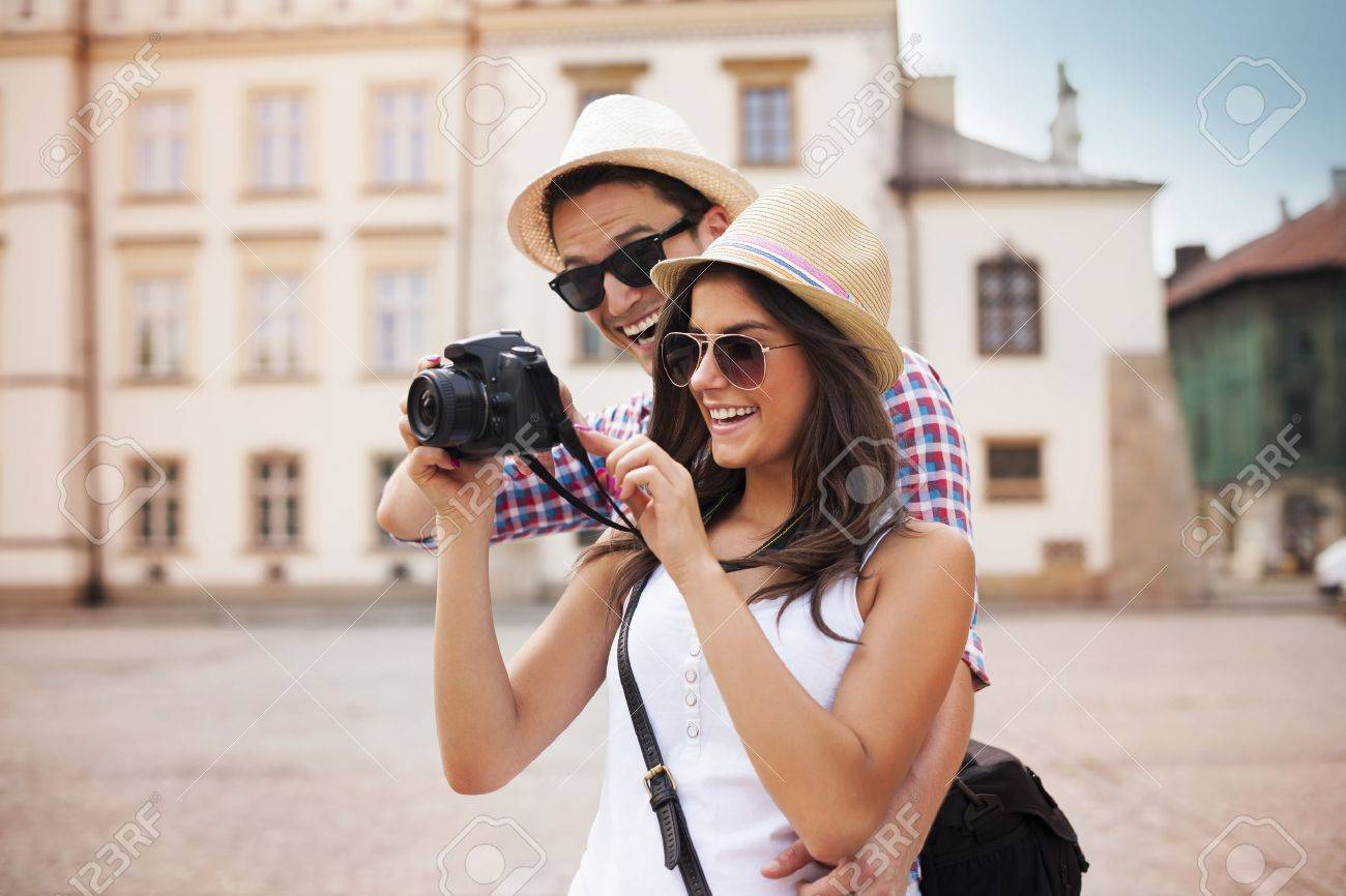 Cute couple looking on their photos on camera Stock Photo - 21027928