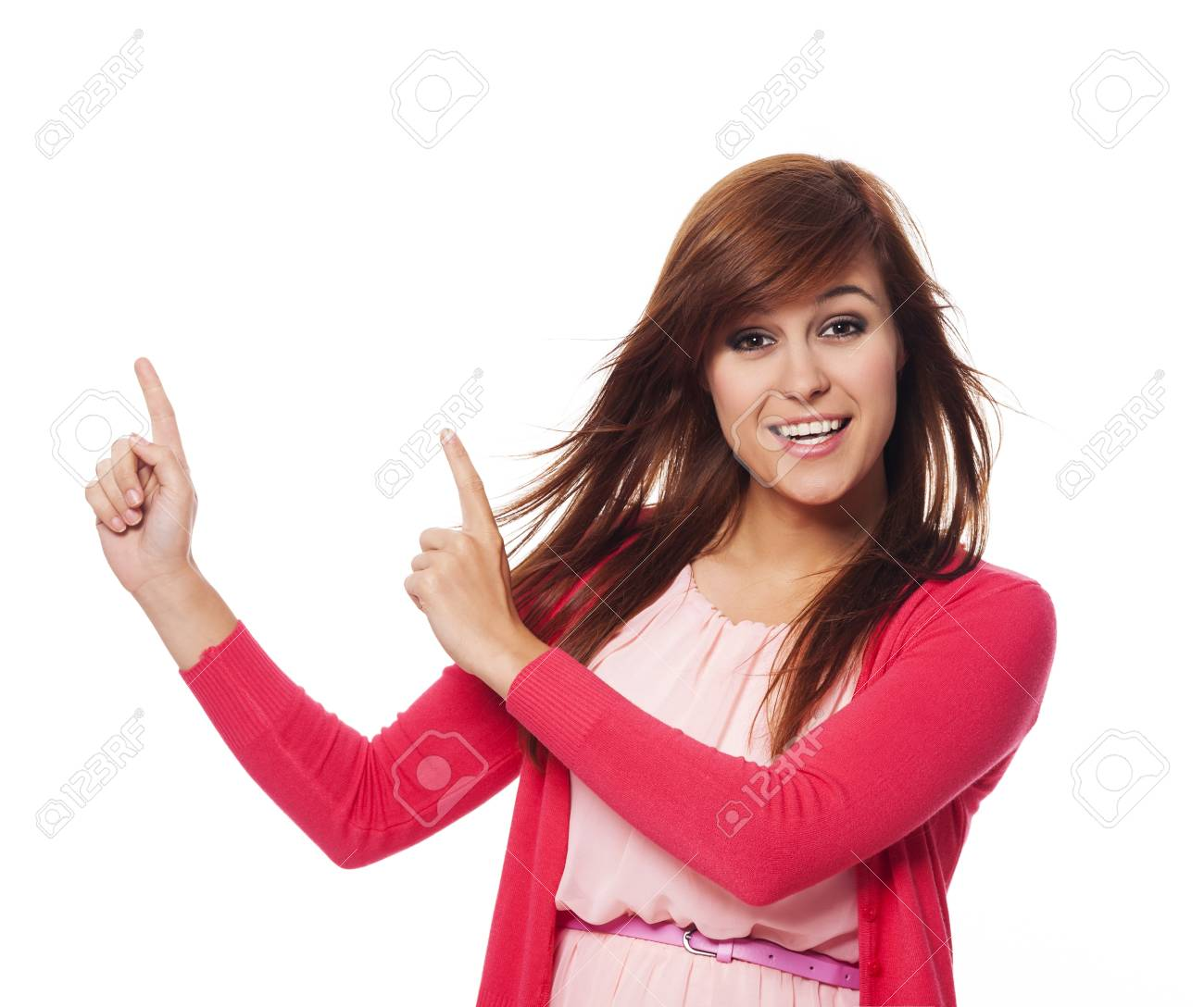 Beautiful woman in pink pointing at copy space Stock Photo - 21534475