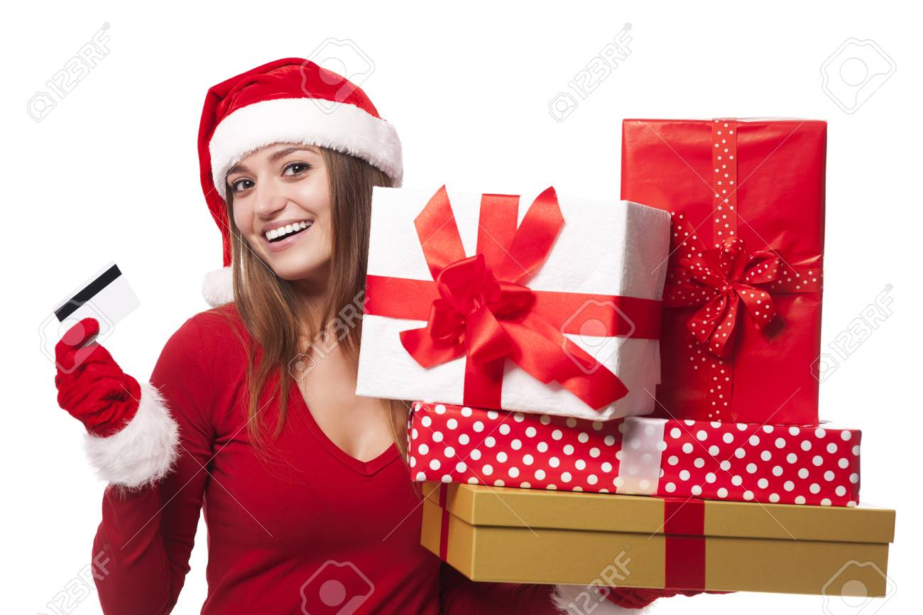 Woman wearing santa hat holding christmas gifts and credit card Stock Photo - 22988365