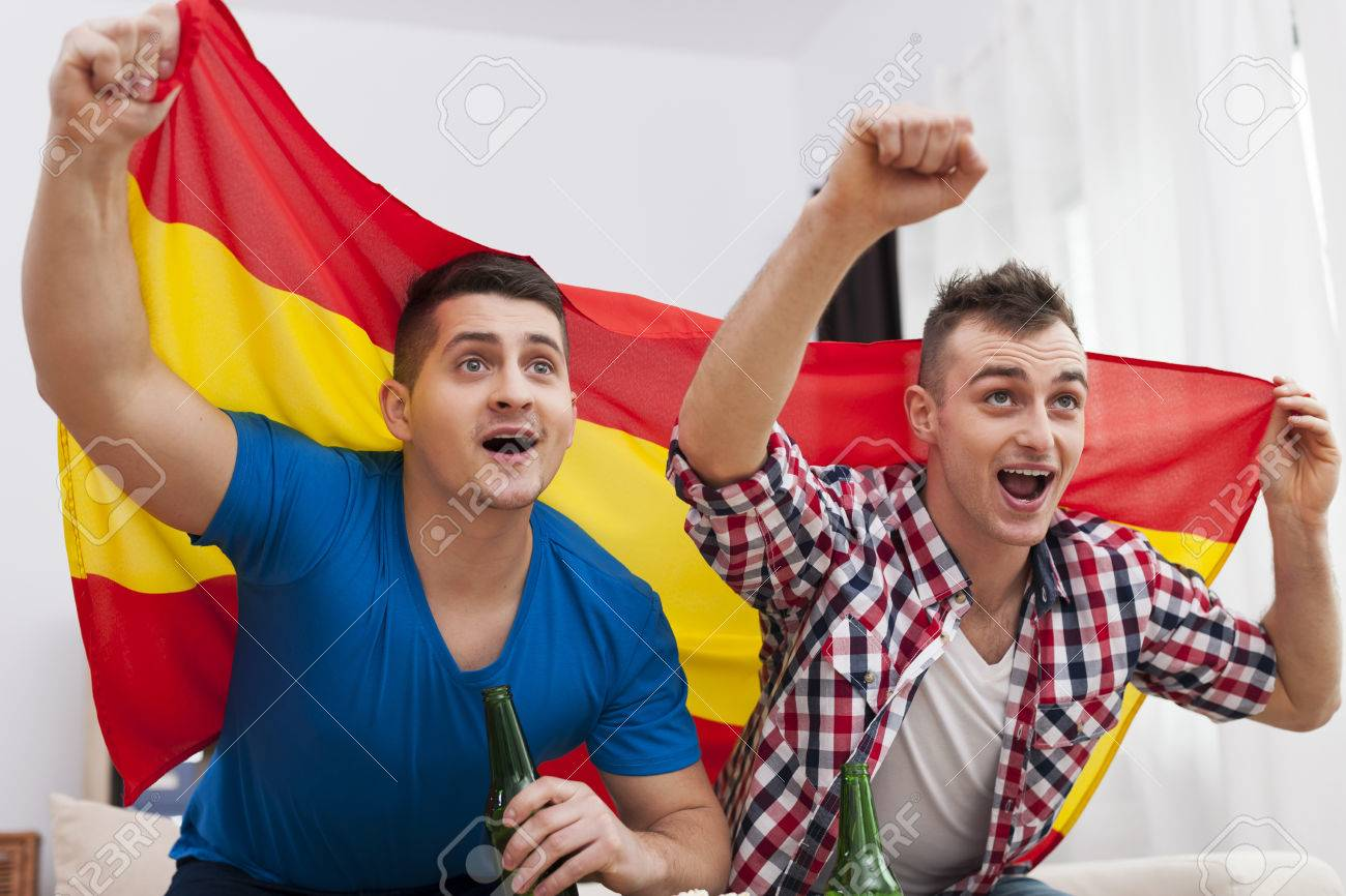 men watching football match on tv and cheering of spanish team men watching football match on tv and cheering of spanish team stock photo 26603387