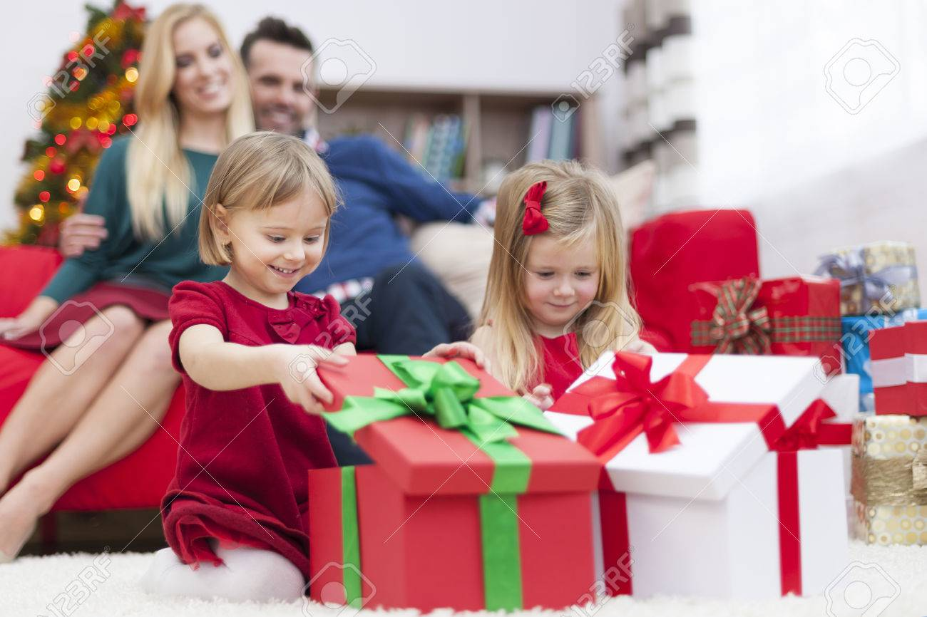 Sweet Little Girls Opening Christmas Presents Stock Photo, Picture ...