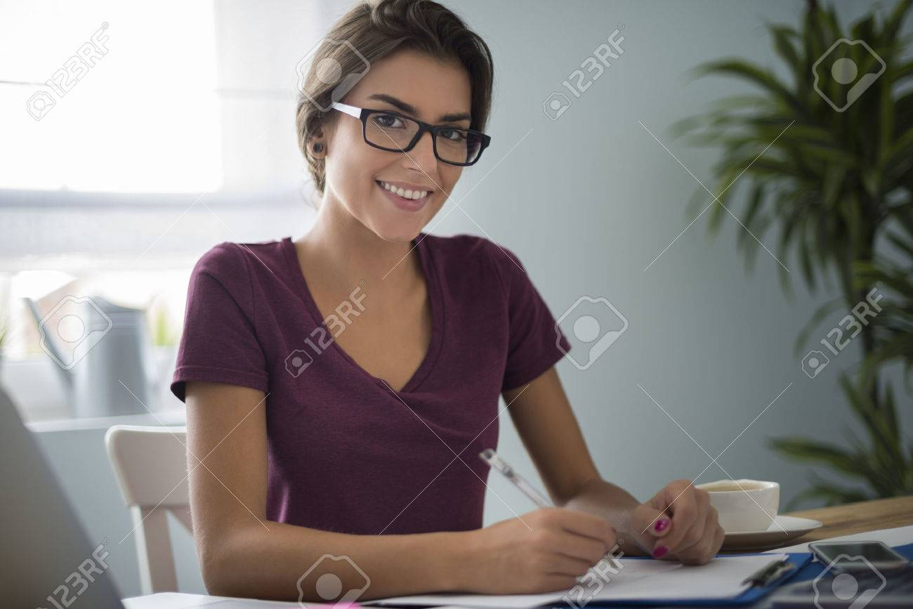 Dutiful woman at her house office Stock Photo - 45884583