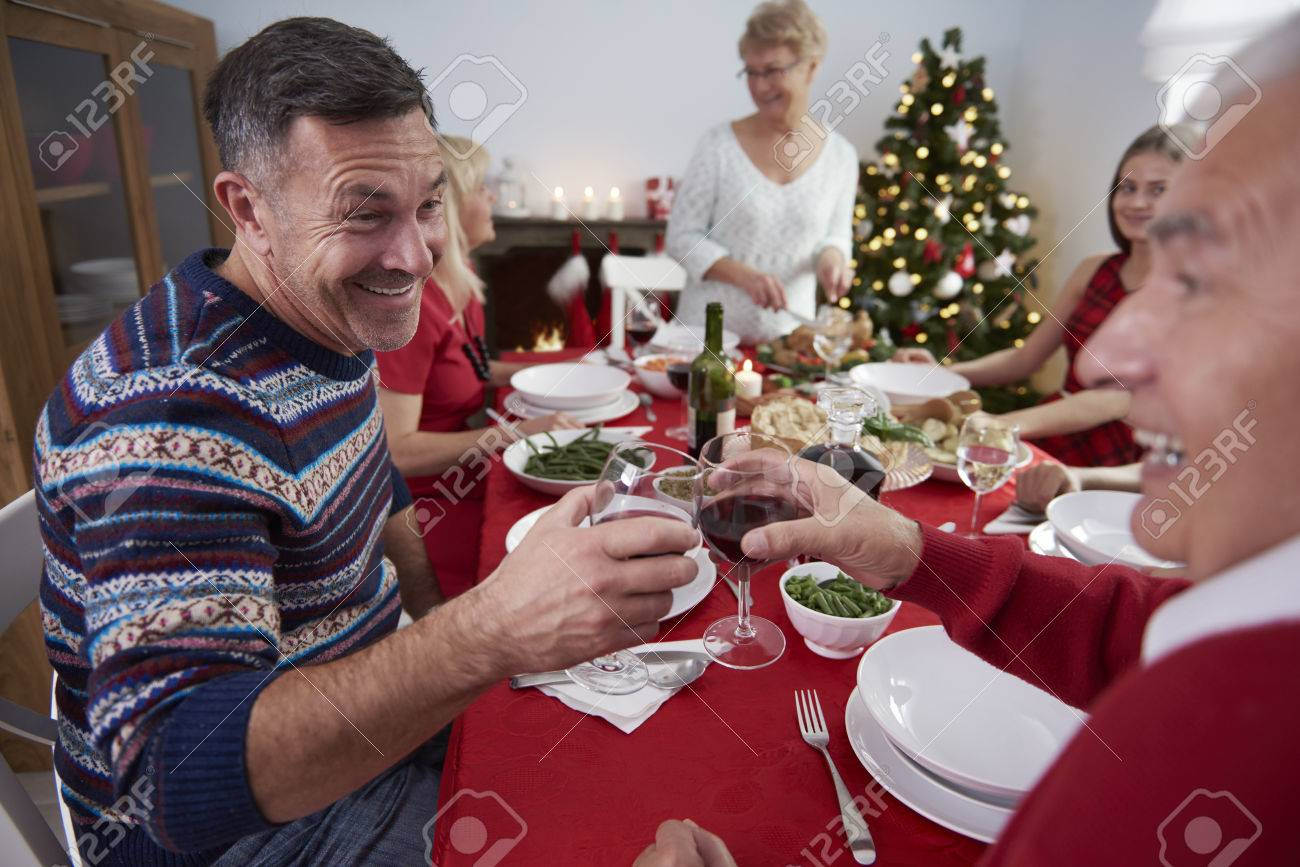 All family gathered at the table Stock Photo - 48086284