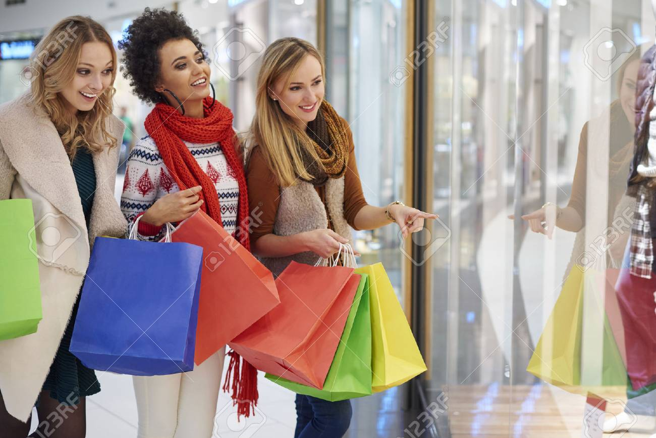 Three best friends during Christmas shopping Stock Photo - 49194808