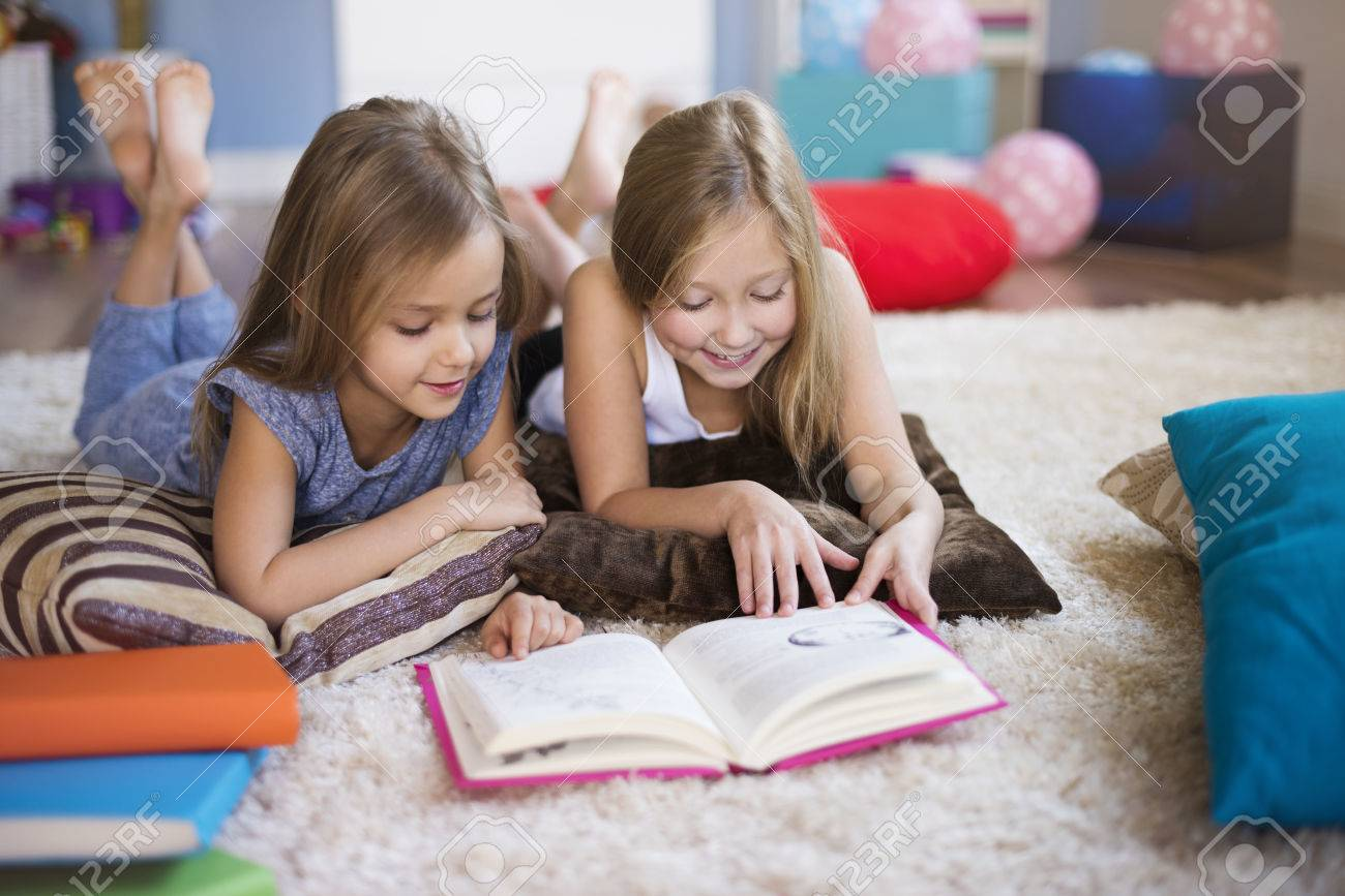 Reading interesting book with sister - 51086008