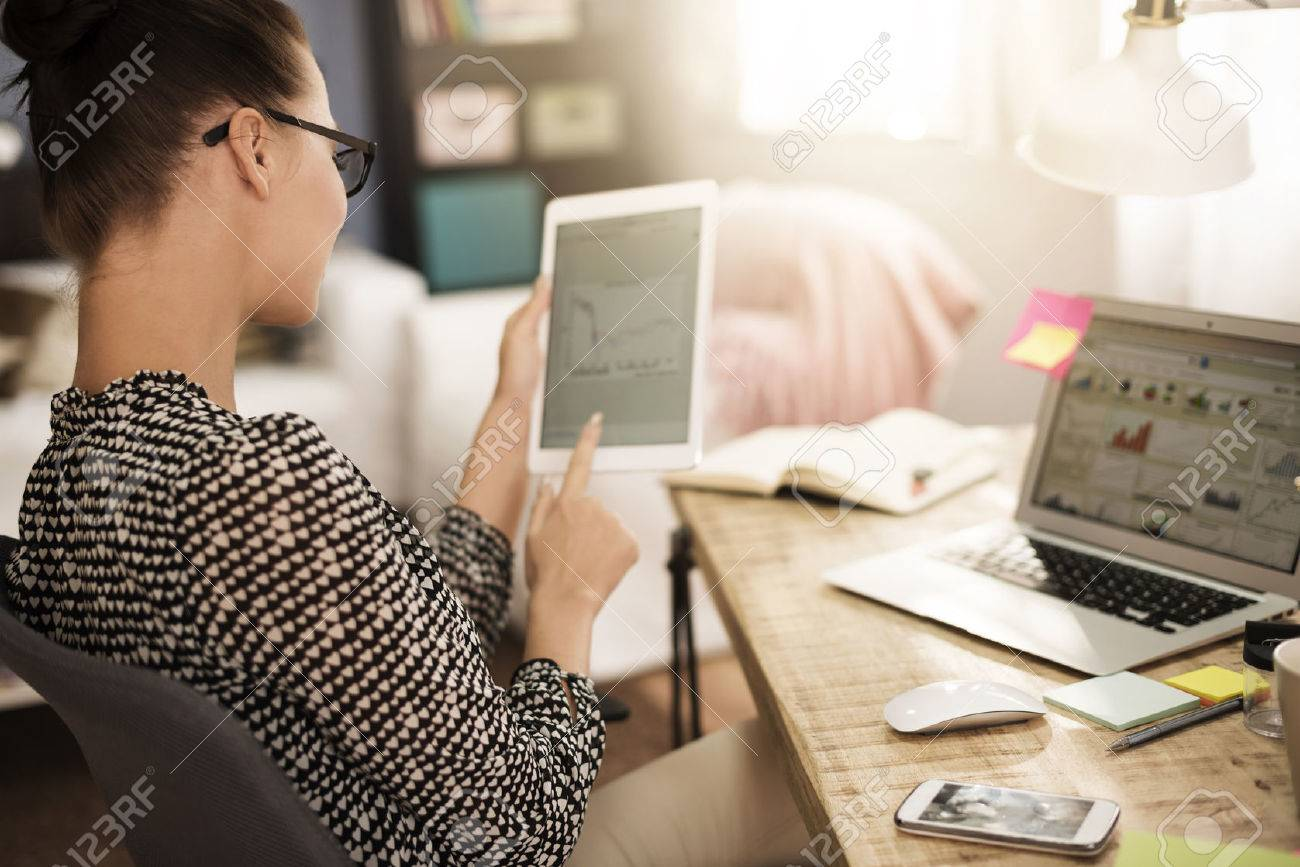 Woman analysing some very important data Stock Photo - 51955464